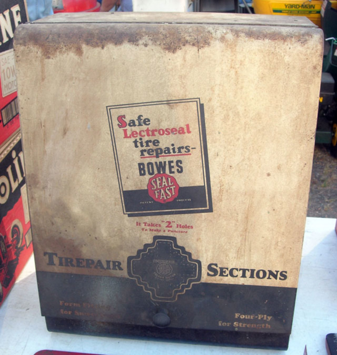 """Vintage Bowes Seal Fast """"Tirepair Sections"""" metal flip-front cabinet sold for $165."""