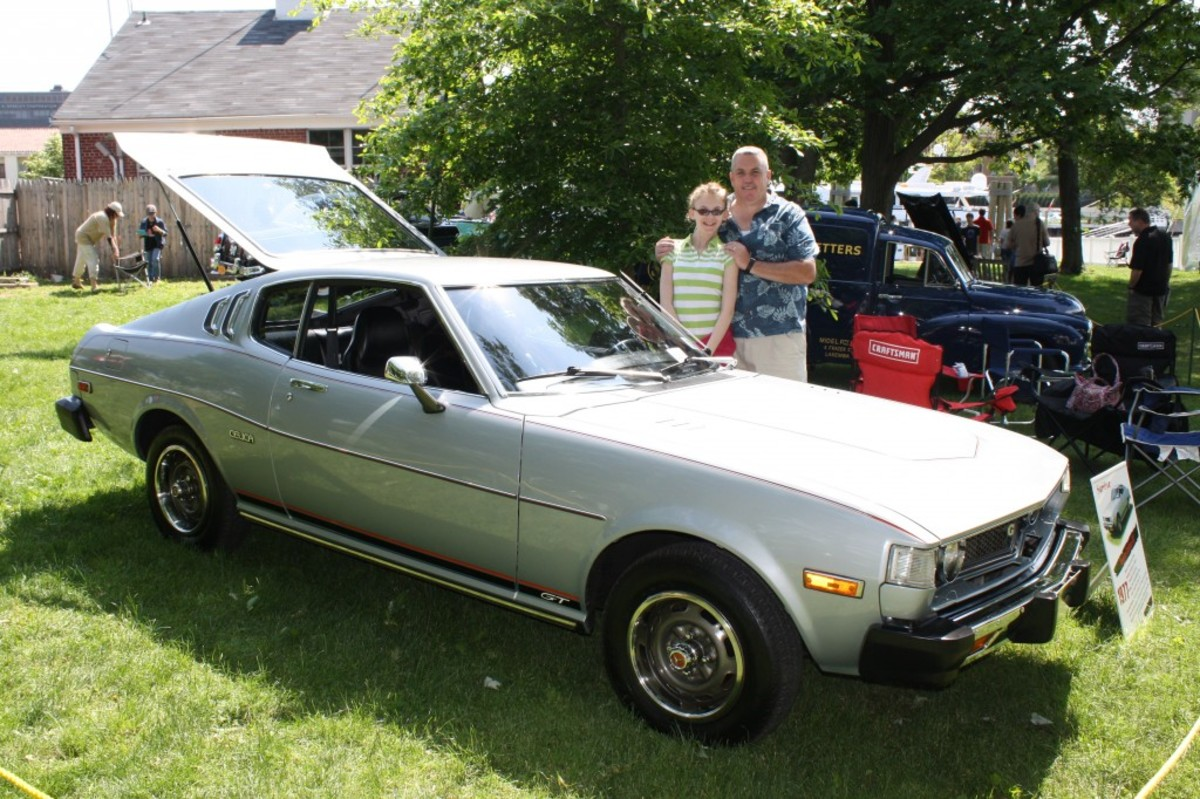 Tom Sullivan and his daughter Mairead, 14, stand next to his 1977 Toyota Celica during the 2011 Greenwich Concours International.