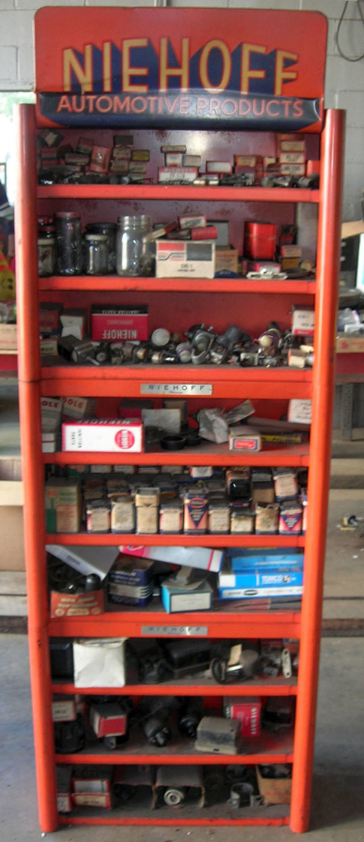 This nine-tiered Niehoff Automotive Products display shelf filled with NOS parts was sold as two lots. The NOS parts all sold for $165, while the shelving unit went for $225.