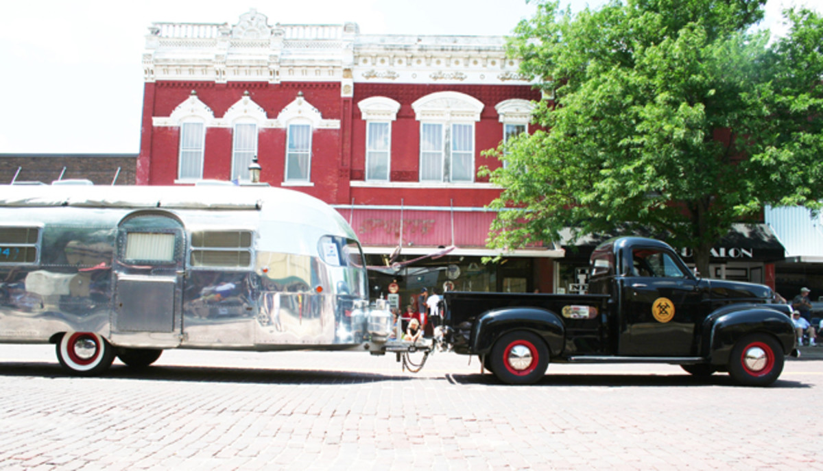 This restored travel trailer, being towed by a 1948 Studebaker pickup, was one of a number of similar rigs turned out for the centennial celebration by the Tin Can Tourists, which was organized in 1919.