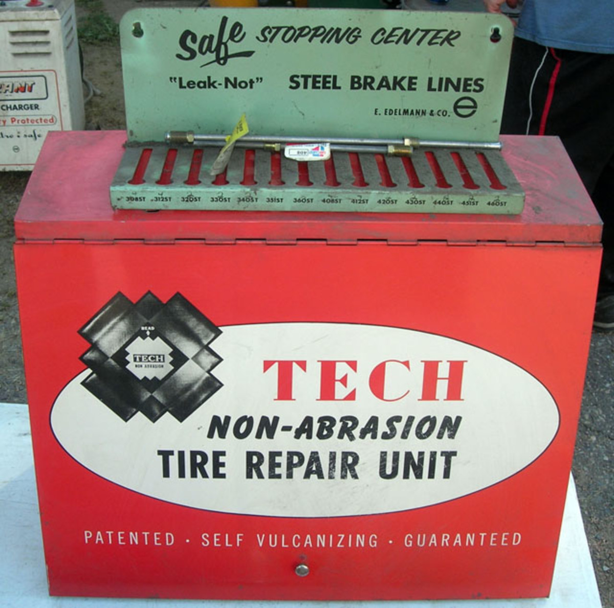 One of two identical parts display units offered, this Tech tire repair metal flip-front cabinet sold for $40. The same buyer bought both for $80.