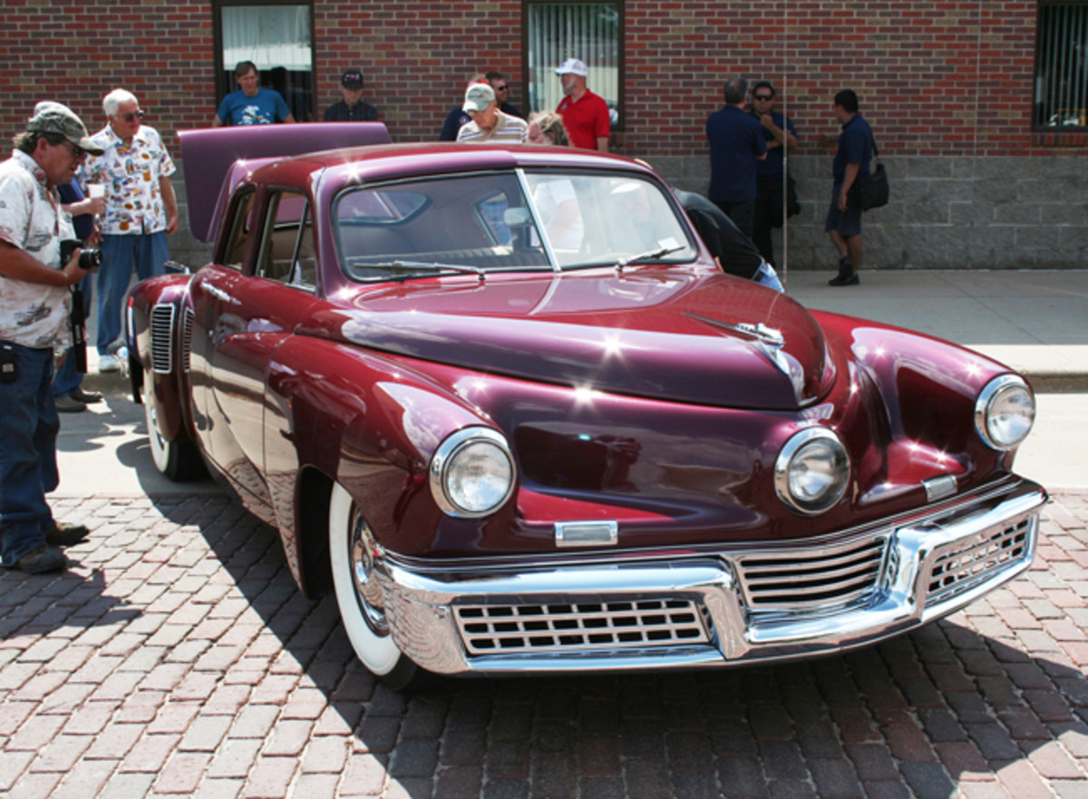 1948 Tucker from the Richard Dreyfus collection of Chicago made the West-to-East tour. Advanced for its day, the stylish sedan with rear-mounted, air-cooled six-cylinder aircraft engine had a crowd around it all day.