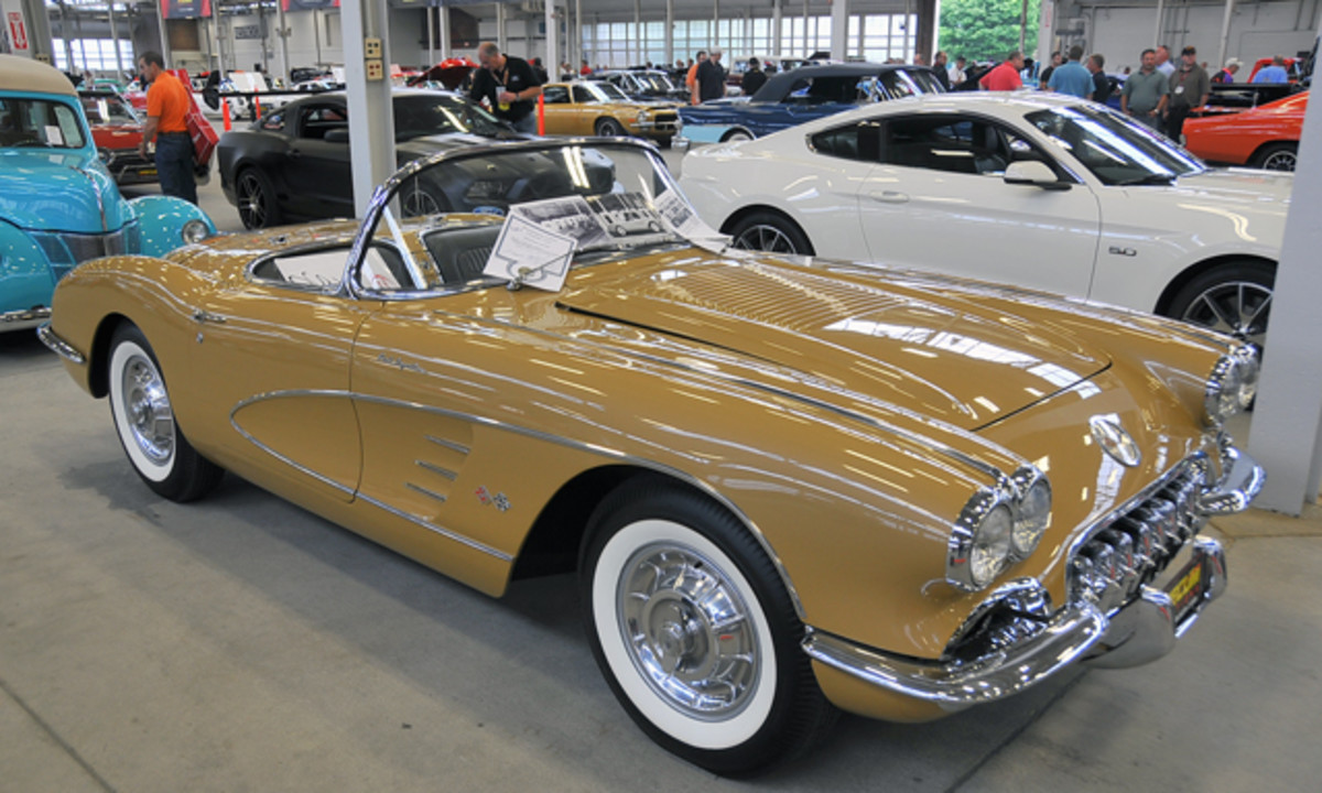 "The specially painted gold ""39 Millionth Corvette"" (right) found a new owner for $155,000."