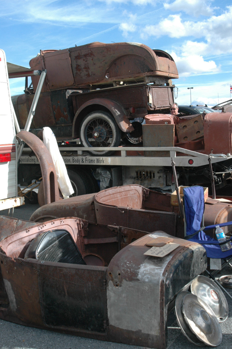 Looking like a scene out of a salvage yard 50 years ago, this vendor's portable heap of early Ford iron was largely composed of Model T body parts.