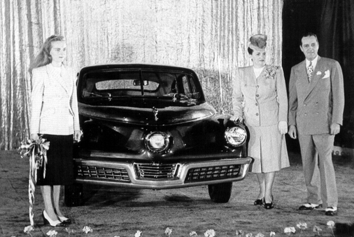 Tucker Unveiling: Showing Marilyn Lee, her parents Vera and Preston Tucker at the public unveiling of the very first Tucker on June 19, 1947.
