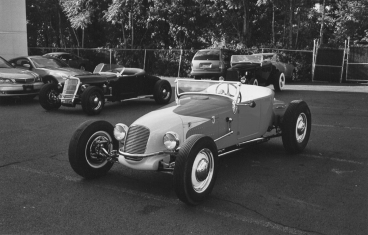 The petite grille on Jerry's T was a genuine Miller, reportedly purchased for a mere $8. Its scale is perfect for this car. A Farm-All tractor radiator fits snugly under the hand-formed track nose. The neat hood and the louvered side panels were hand-formed from 16-gauge steel.