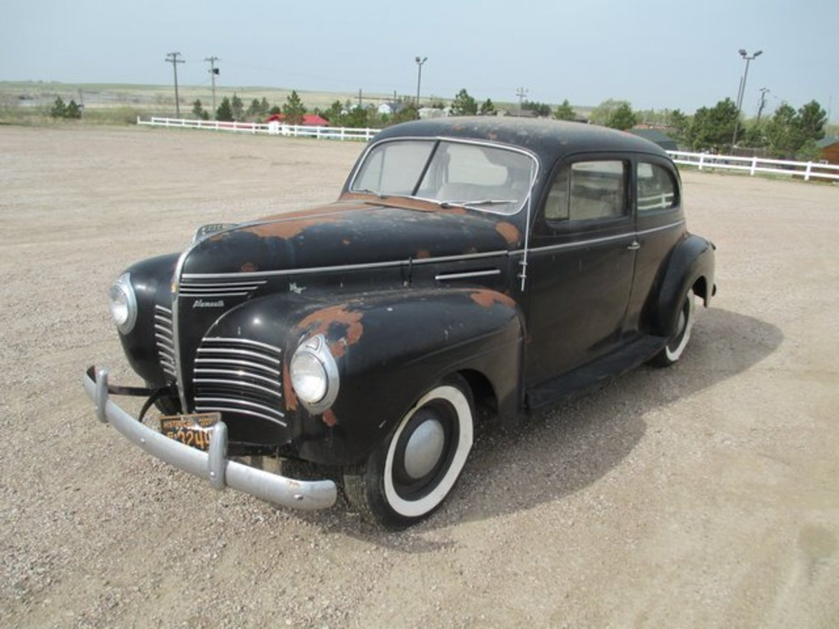 Auction Lot 13: 1939 Plymouth barn fresh estate cars from the John Geisler estate.
