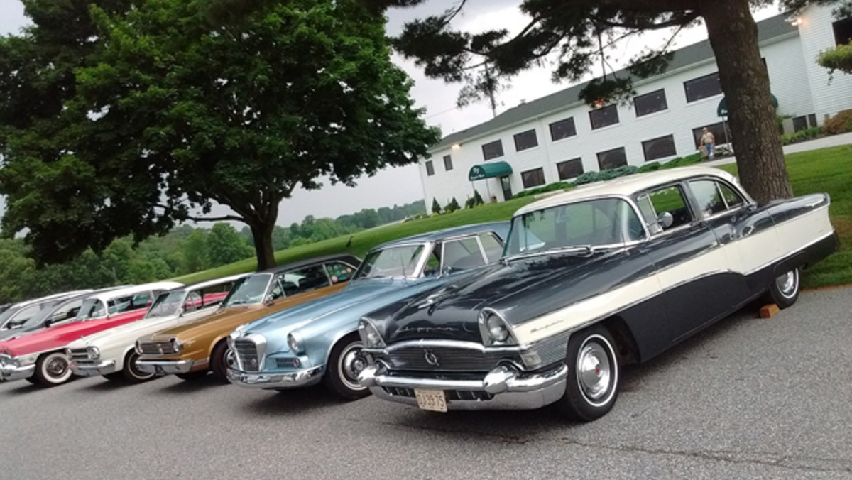 Two Packards, two Ramblers and a Studebaker Hawk parked in front of Friendly Farm Restaurant at the end of the tour. (Photo by Bob Baer)