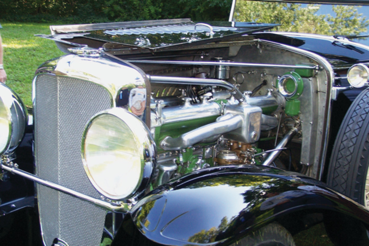 That's 420, Indy-influenced cubic inches of straight-eight engine producing 265 hp behind an early Duesenberg V-core radiator. Notice this early car from 1929 was not retrofitted with the Pines radiator shutters or trumpet horns. While the car retains nearly all of its original paint, the engine was freshened with a new coat of apple-green paint.
