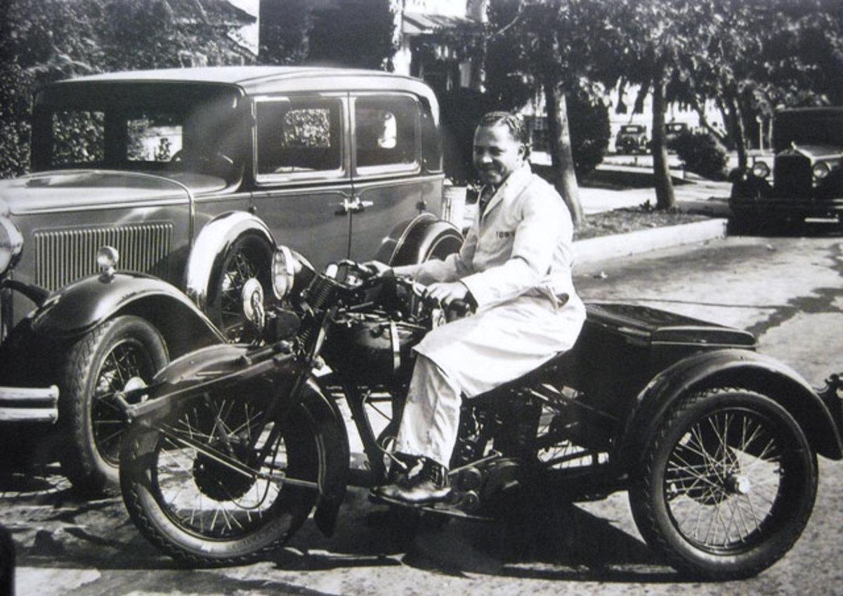 A Servi-Car driver arrives to pick up a car.