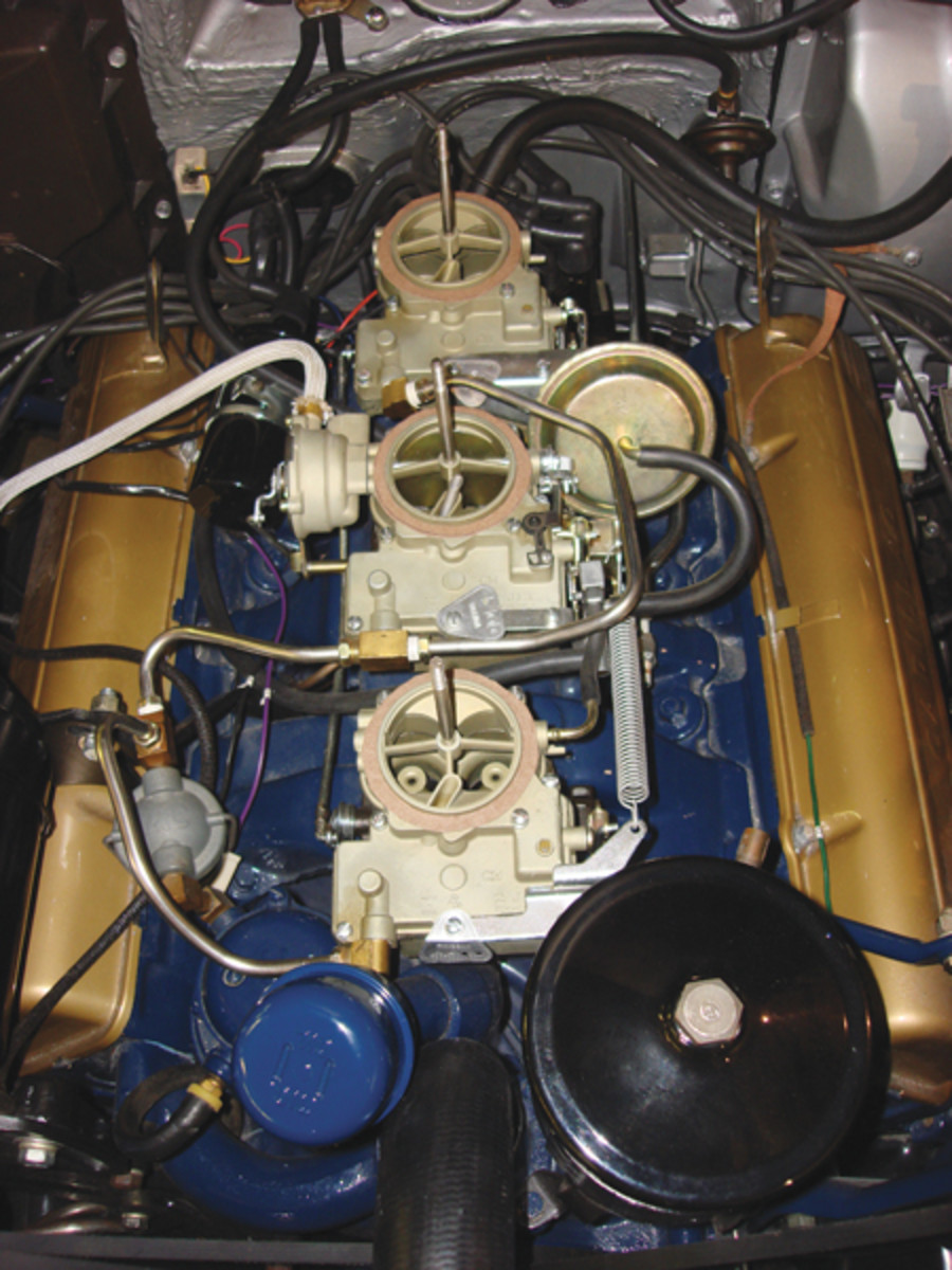 Making the tri-carburetor setup on Prehn's 1958 Eldorado properly function took a lot of effort. The blue 365-cid's valve covers are gold and match the air cleaner (not fitted in this photo).
