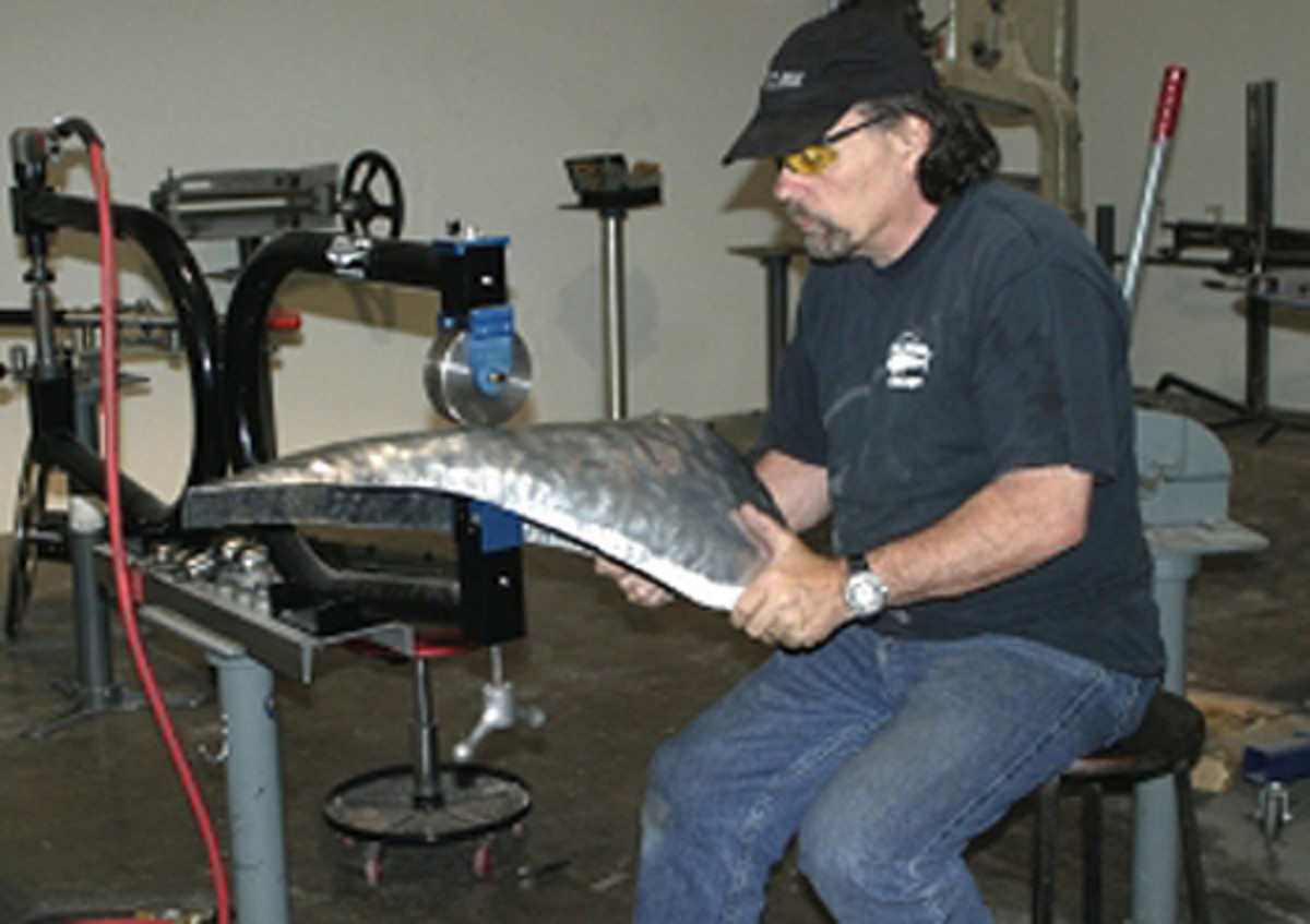 """After a panel is pounded out """"roughly"""" on a sand bag, it needs to be wheeled into a smoother finish. Wheeling takes some time and you should be as comfortable as possible, so find a chair of the proper height and take your time."""