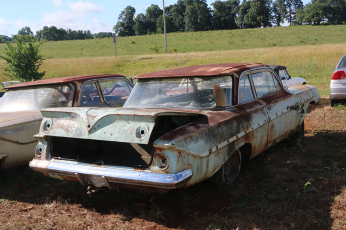 A pair of '61 Chevrolet Bel Air two-door sedans are available for parts removal. There are many additional full-size 1960s Chevys in the yard.