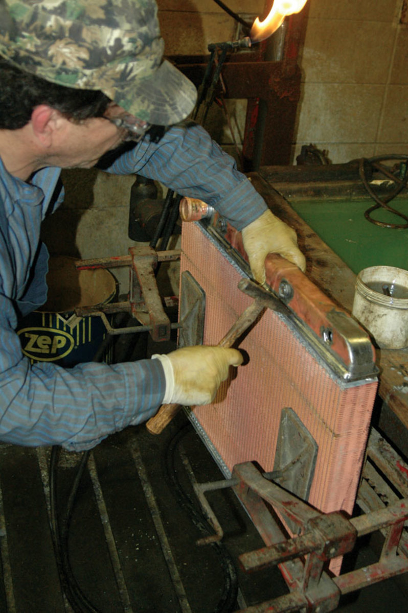 Here Fronholtz solders and assembles a radiator for a 1973 Plymouth Duster.