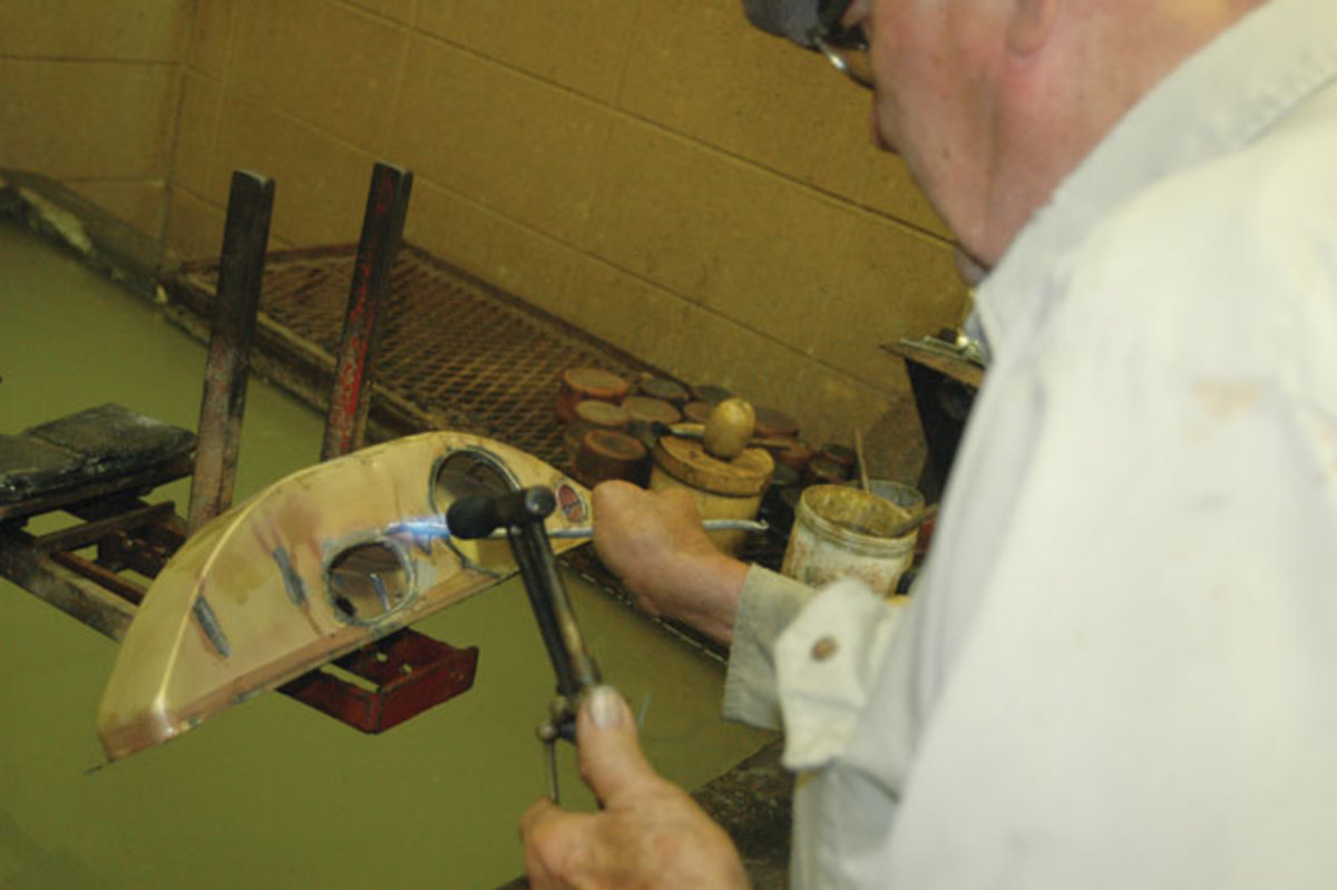 Ray Schirmer Sr. still does plenty of hands-on work on collector car radiators. Here he solders a 1931 Buick tank.