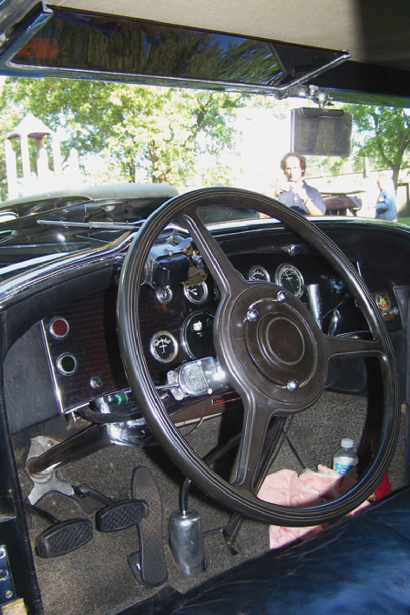 Aside from the turn signal switch, and a radio face at the right-hand side of the instrument panel, the interior is as Duesenberg upholstered it, down to the black-and-white pepper-pattern carpeting. This carpeting also lines the rumble seat area.