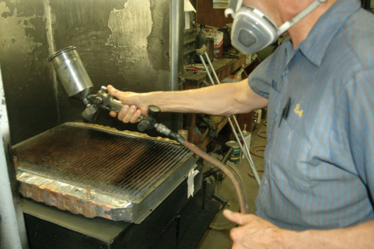 Bob Schirmer applies some black finishing paint to a radiator at Glen-ray Radiators in Wausau, Wis. The family- run business began in 1964, and in recent years has been specializing in repairing and reproducing radiators for big-block Chrysler Corp. muscle cars.