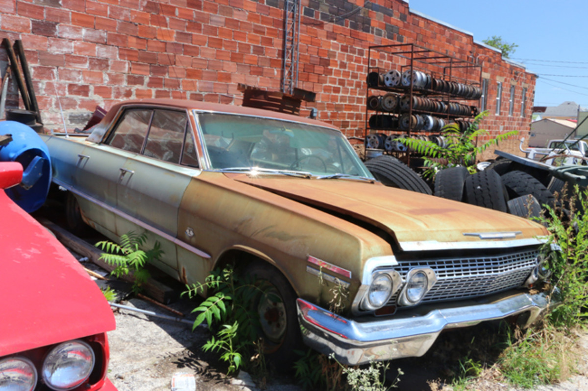 Located downtown behind the tire shop is this 1963 Chevy four-door hardtop with a factory installed 409-cid engine.