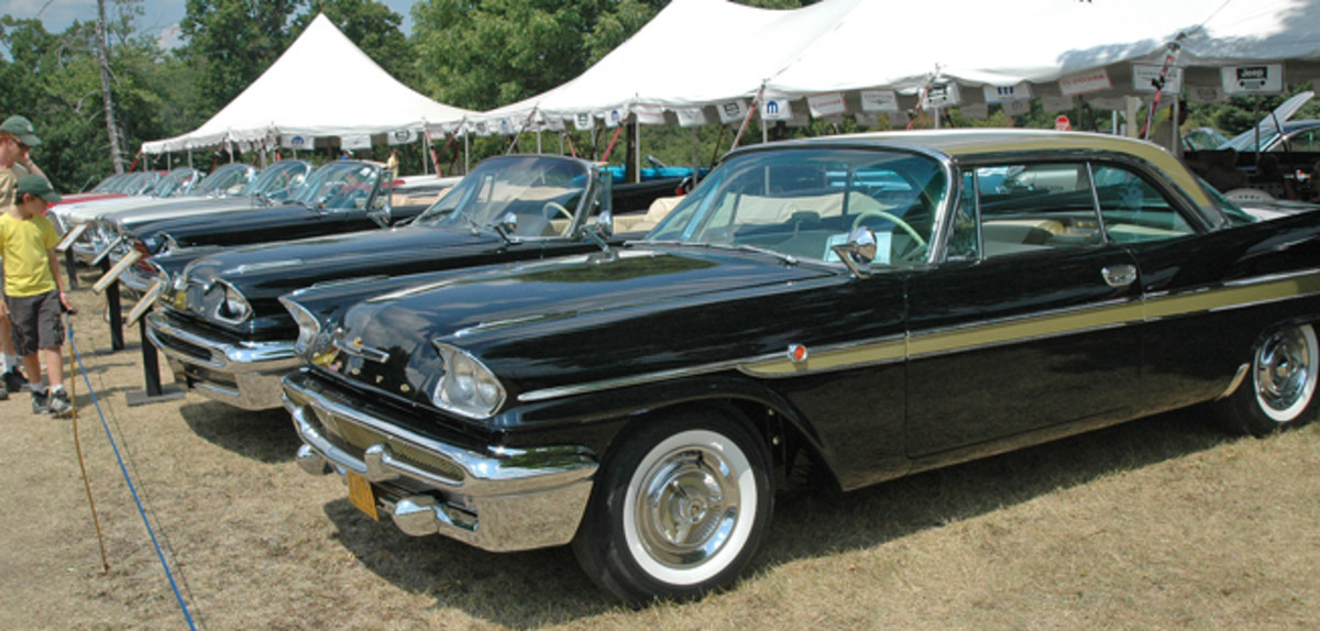 You'd be hard-pressed to search out a larger display of finned Mopars — especially convertibles — than you'll find at the northwest corner of Iola's Blue Ribbon Concours. This lineup is led by a 1958 De Soto Adventurer hardtop, which flanks a 1957 Adventurer convertible and a 1959 Chrysler 300-E convertible.