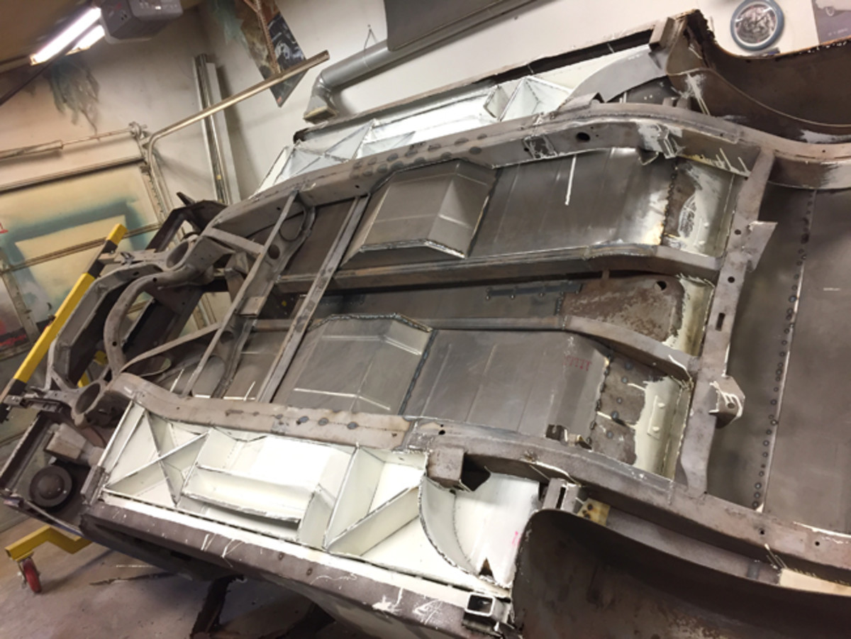 The new floor pan from below. Bracing was added to the production Mercury frame since the structure was weakened from recessing the floors. The white area is the KBS Coatings rust-proofing product.