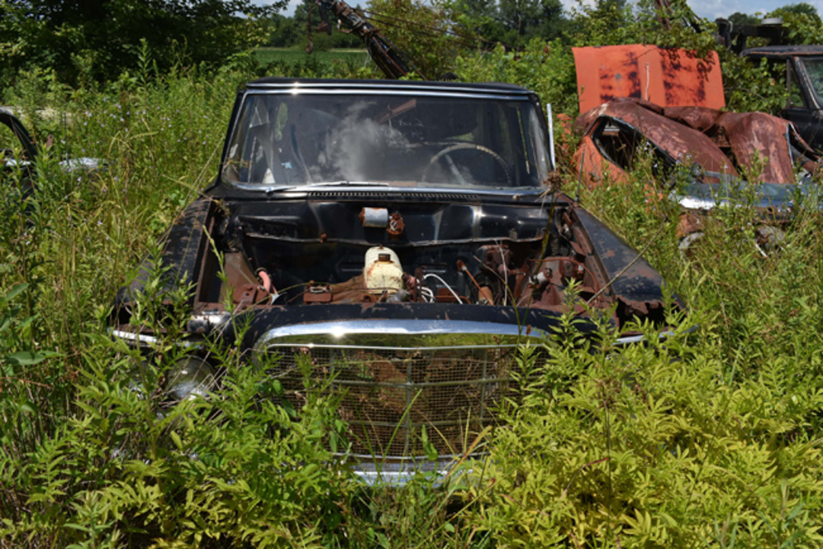 Missing a hood and trim bits, lots of parts remain on this 1962 Studebaker Lark sedan at Purdin's.