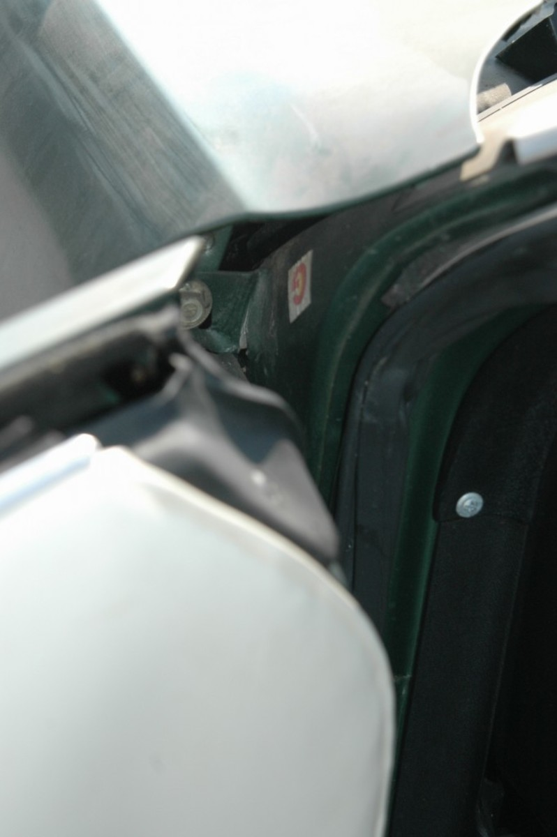 """This """"G"""" sticker is inside the driver's door jamb, at the cowl."""