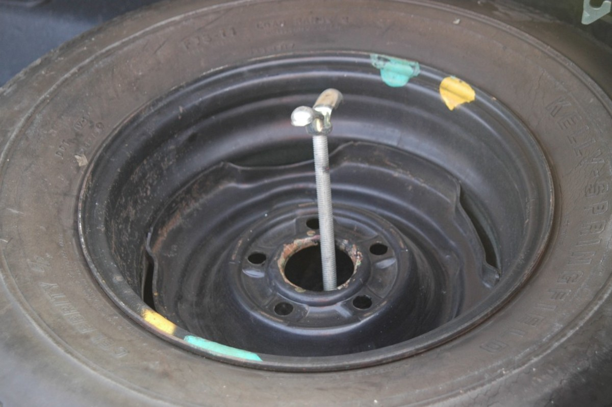 Note the paint marks on the trunk-mounted spare tire wheel.