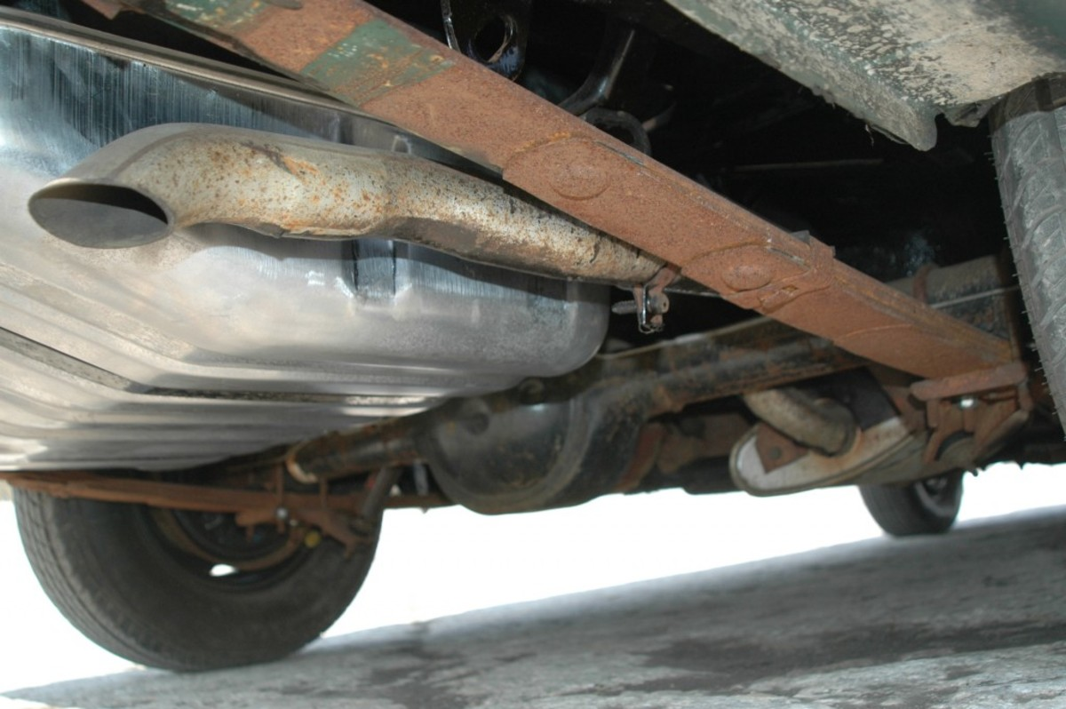 A view from behind the passenger side rear corner of the Mustang. Note the stripes on the leaf spring and the finish beneath the car. Note: The gas tank had to be replaced and is not original.