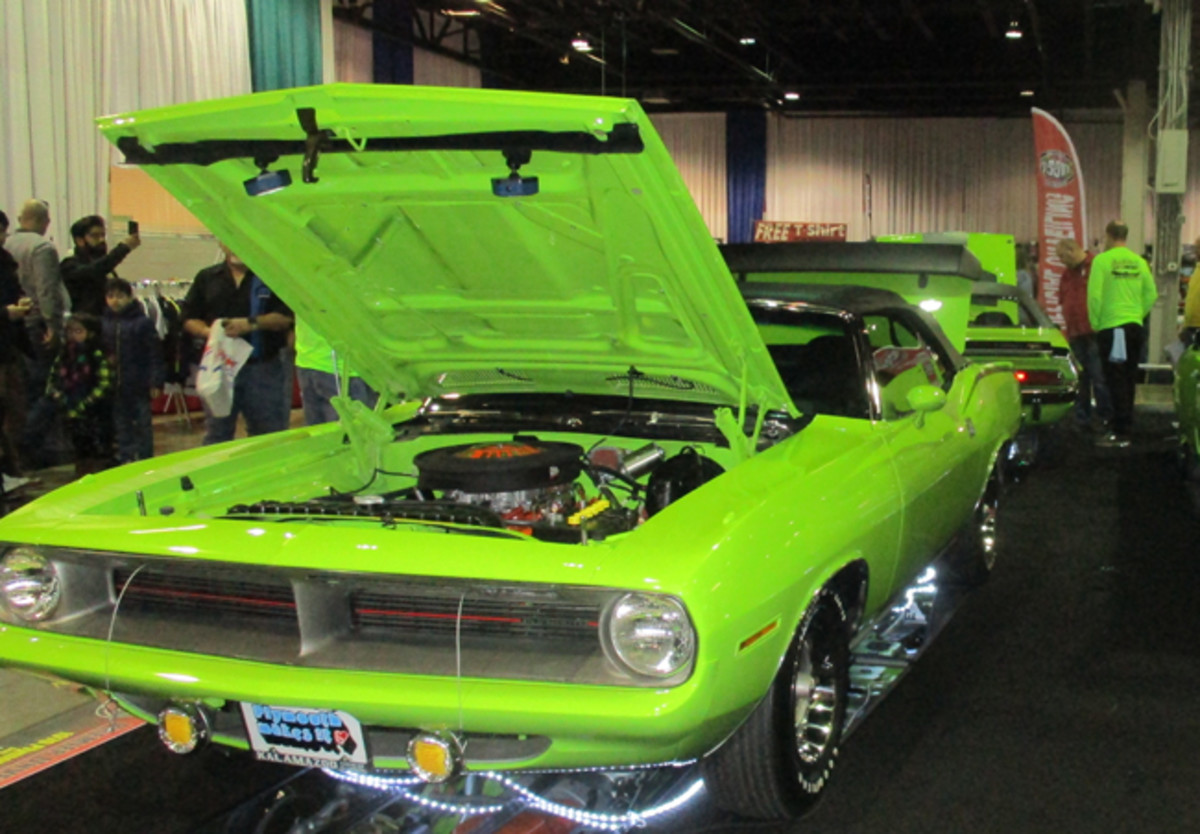 """MoPar Dodge """"Six Pack"""" and Plymouth """"6BBL"""" cars in their respective High Impact Paint color of EF6 Bright Green (Dodge) and Rallye Green (Plymouth) color made an eye-catching display."""
