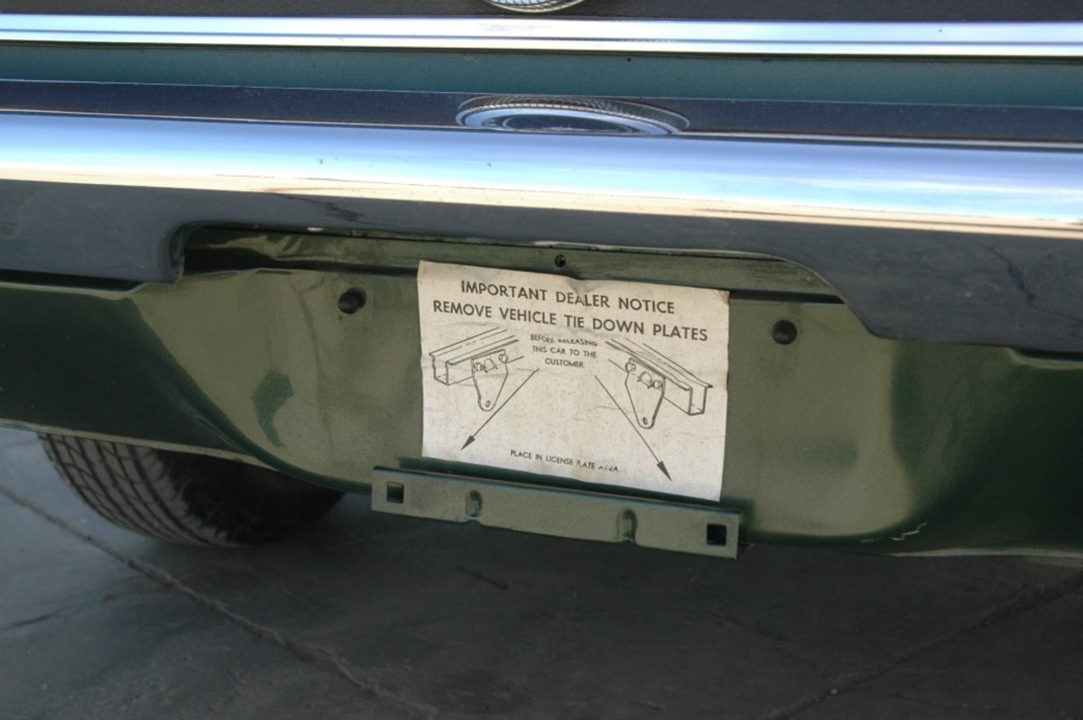 The dealer never removed this sticker from the rear valance panel of the car, not did it remove the brackets that sticker instructed them to remove.