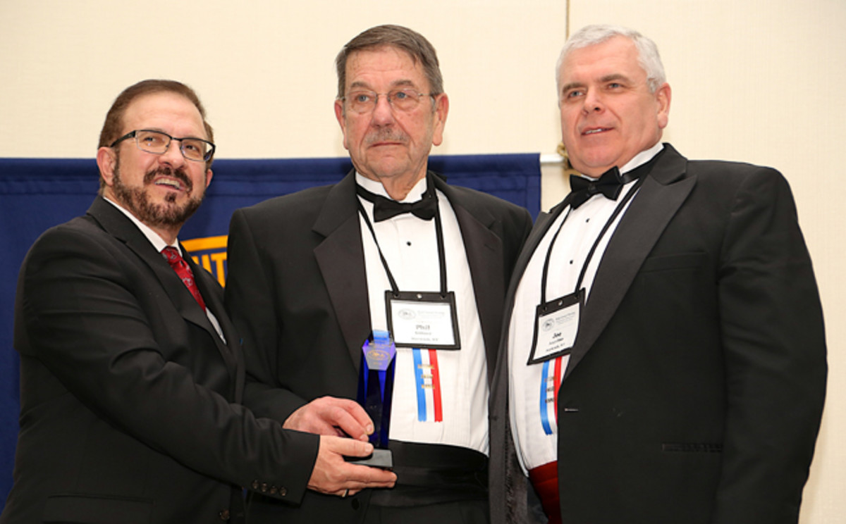 (L to R) Thomas Cox, President of the Antique Automobile Club of America, presents to Northeast Classic Car Museum representatives Philip Giltner and Joseph Angelino the 2017 AACA Plaque award recognizing outstanding achievement in preserving the history of the automobile.
