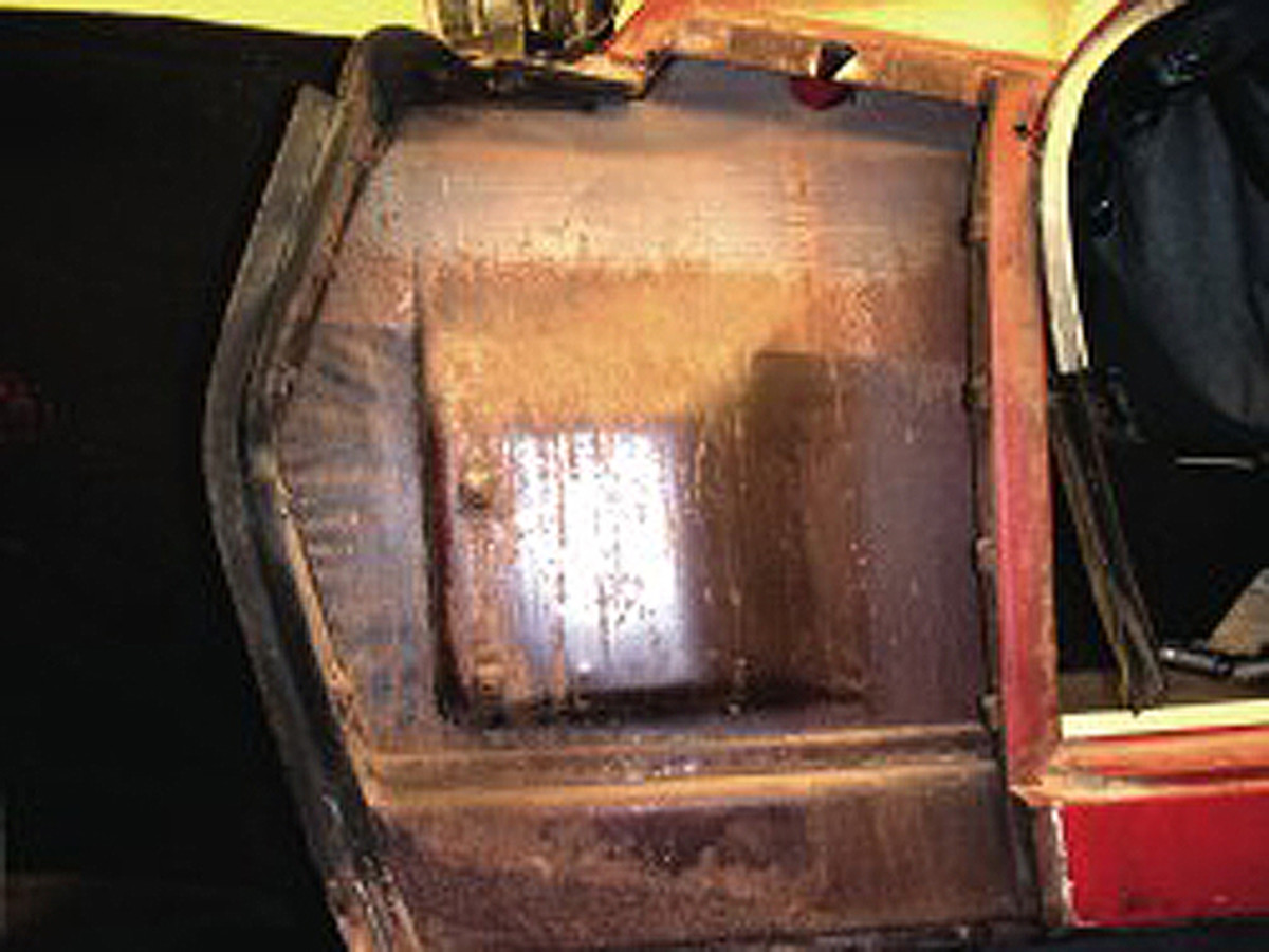 Areas like this inner fender should be taken to bare metal, painted, and undercoated. Note that the factory was kind enough to leave this area in raw metal below the horizontal paint line that is visible. It is completely unprotected. While restoration aims at authenticity, this is one place were it is OK to deviate from that ideal and give this metal some protection.