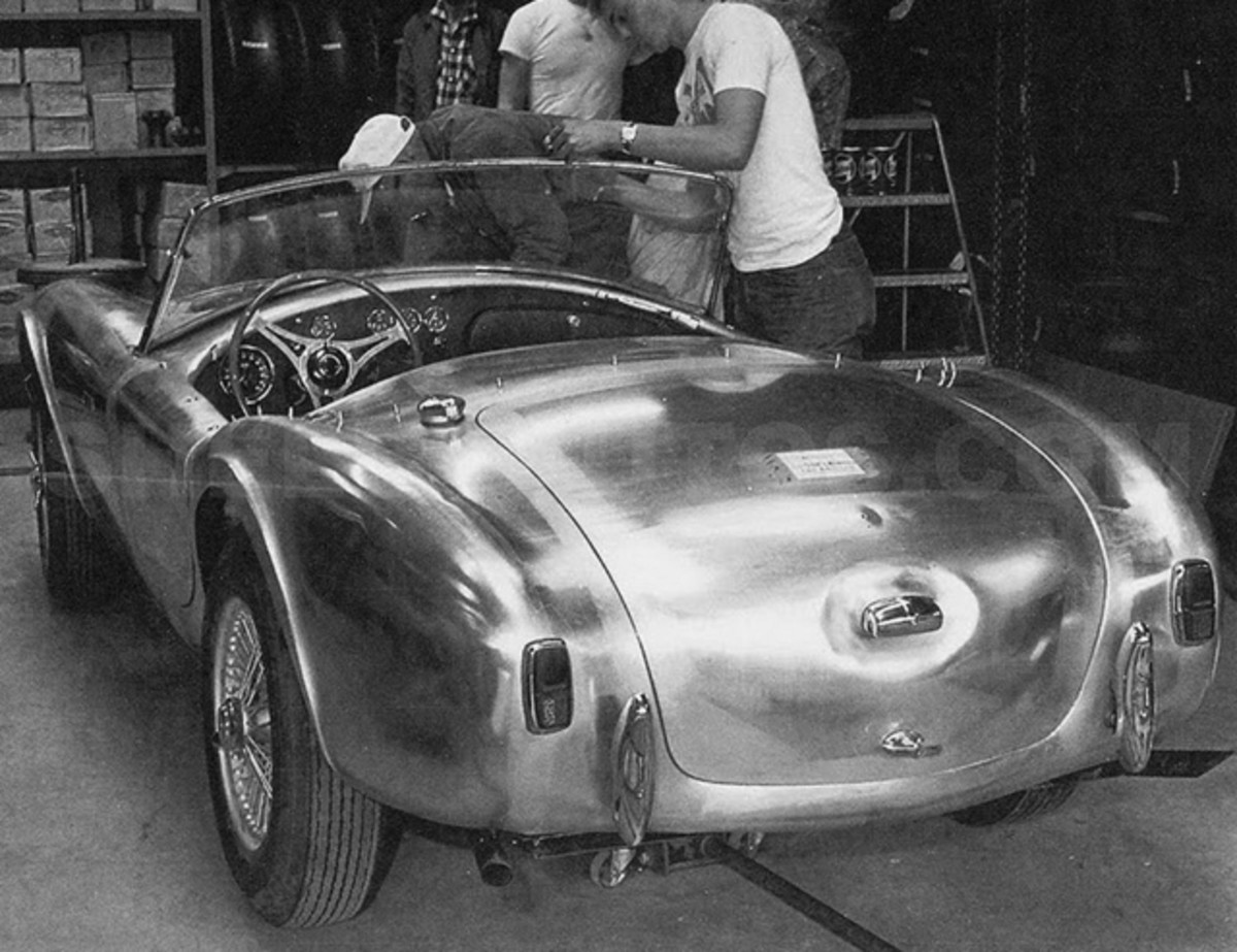 Carroll Shelby's team installed the Ford engine and transmission in the Cobra prototype chassis at Dean Moon's shop in Santa Fe Springs, Calif.