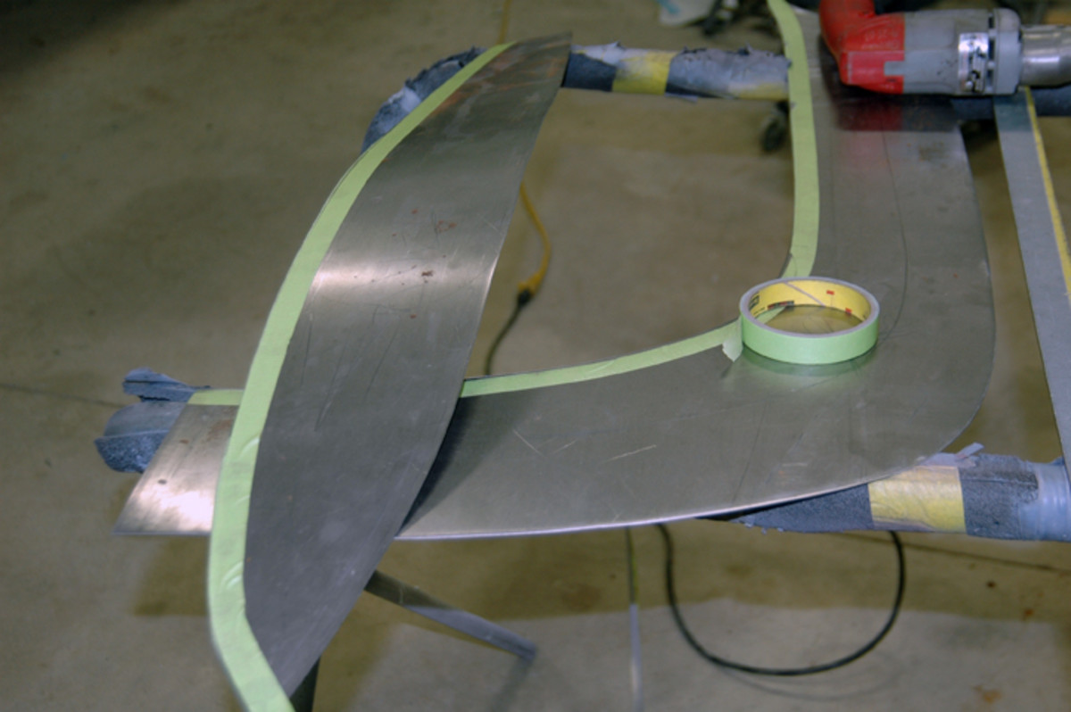 Schrock used a power shears to cut the sheet metal that will form the lip (top metal sheet). Since the lip will be 3/4 inches wide, a piece of tape matching that width was run along the edge of his cut and then the metal was again cut along the opposite edge of the tape strip.