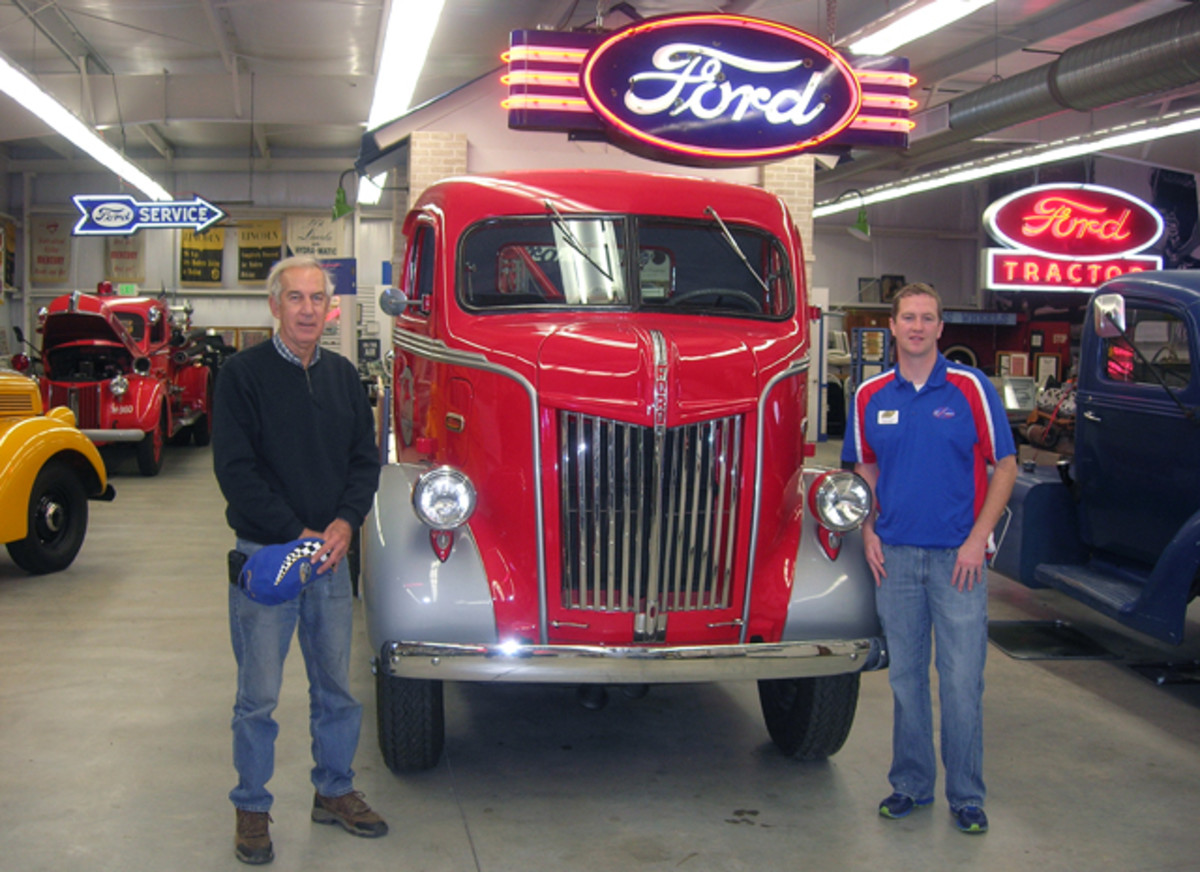George Elbel, president (left), and Joshua Conrad, collections coordinator, of the Early Ford V-8 Foundation & Museum pose with one of the vehicles on display, a 1947 Ford tow truck originally in service in Barstow, Calif.