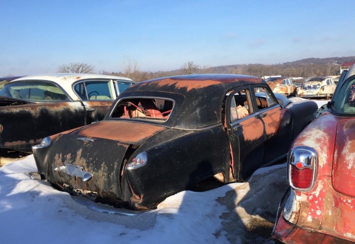 We'll end our visit this time with this 1951 Kaiser Vegabond, a sedan whose rear end opened like a station wagon. They were rare when new and are even rarer today. Let's home an owner rescues some spares before this loner goes to the crusher.