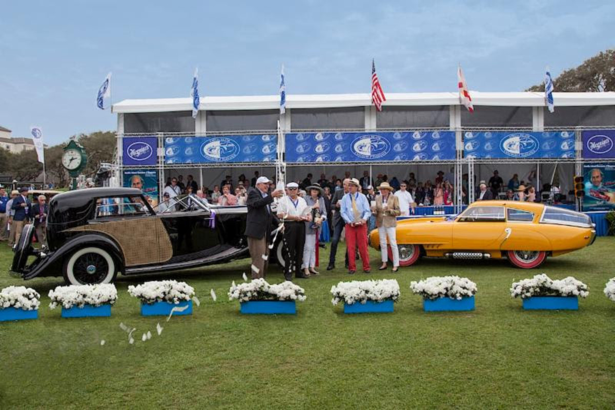 Warner (far left) toasts The Amelia Island Concours d'Elegance Best of Show winners in 2016