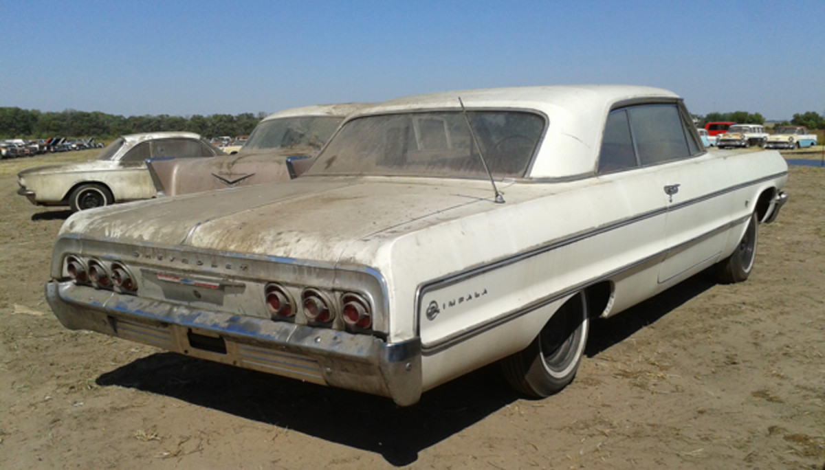 Through the front window of Lambrecht Chevrolet Co., this 1964 Impala with a 327-cid V-8 and three-speed revealed the vintage contents of the dealership. With just 4 miles on its odometer, it sold for $75,000.