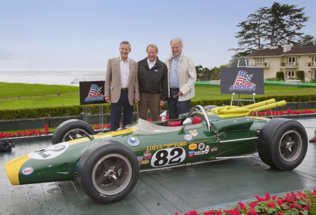 This 1965 Lotus-Ford 38, coming to us from The Henry Ford museum, was the first of the revolutionary rear-engine cars to win the Indianapolis 500. Here, the restored car makes its North American premier at the 2010 Pebble Beach Concours d'Elegance with Edsel B. Ford II (middle) and legendary drivers Bobby Unser and Dan Gurney beside it.
