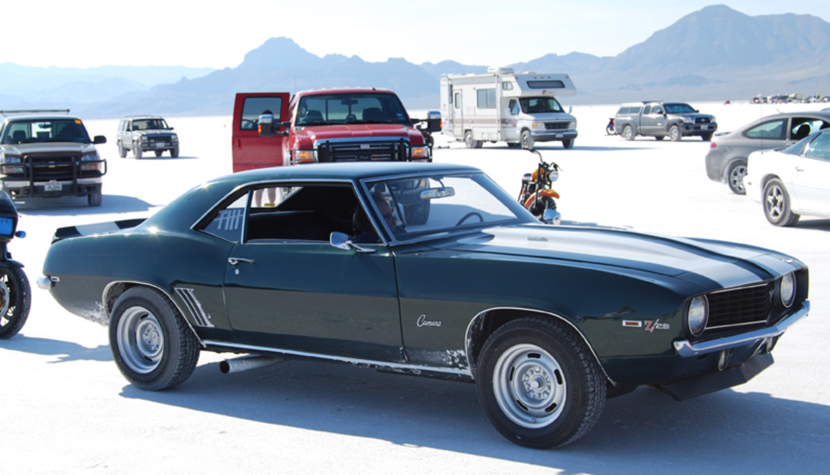"The Sano '69 Z/28 has racing number ""TIII"" taped on rear side window."