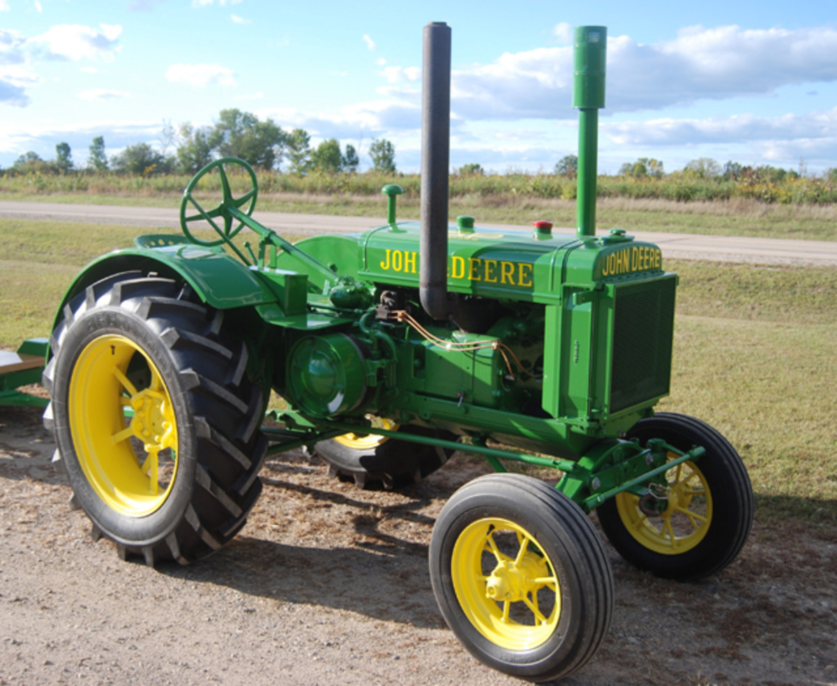 With the economy still hurting, car collectors are looking at tractors and motorcycles, in addition to cars.