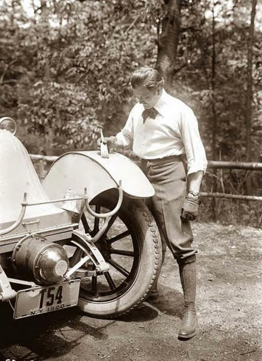 Mr. Thomas of New York painting his car with a brush in 1920.