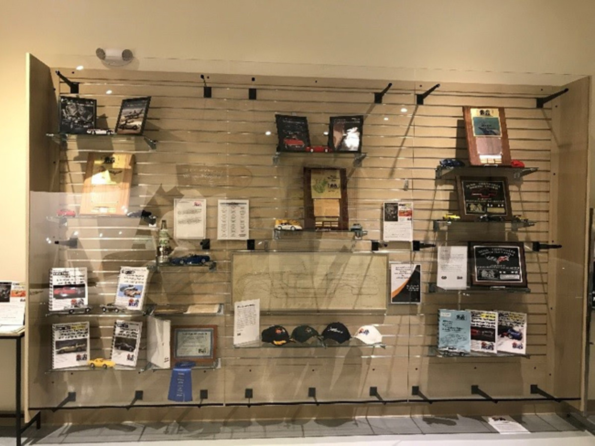 The exhibit case (pictured above) displays additional historic NCRS materials and Technical Information Manual & Judging Guides, NCRS awards and information specific to the Corvette display.