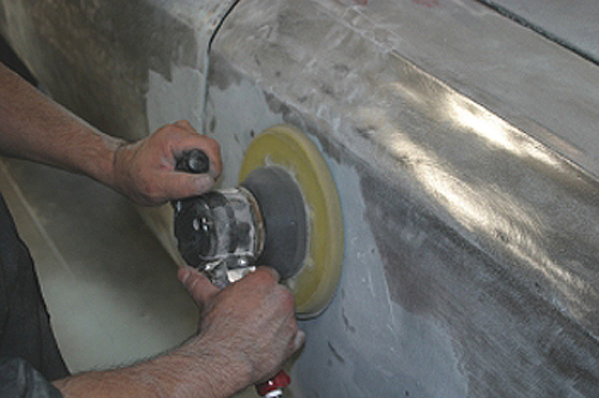 A large DA sander is then used to sand the surface down; or you can pre-cut it, using a sure-form rasp, or cheese grater. This will show you the high spots that are in the fender.