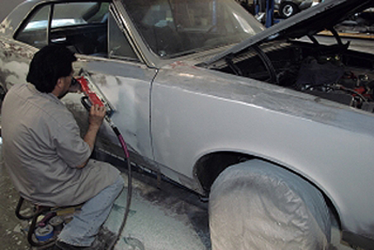 The fender is primed and Brian moves to the next panel and starts over with the air file. As he finishes one panel, he moves to the next one. His finishing bodywork will include wet sanding with finer grits of paper, followed by more priming and prepping the car for paint.