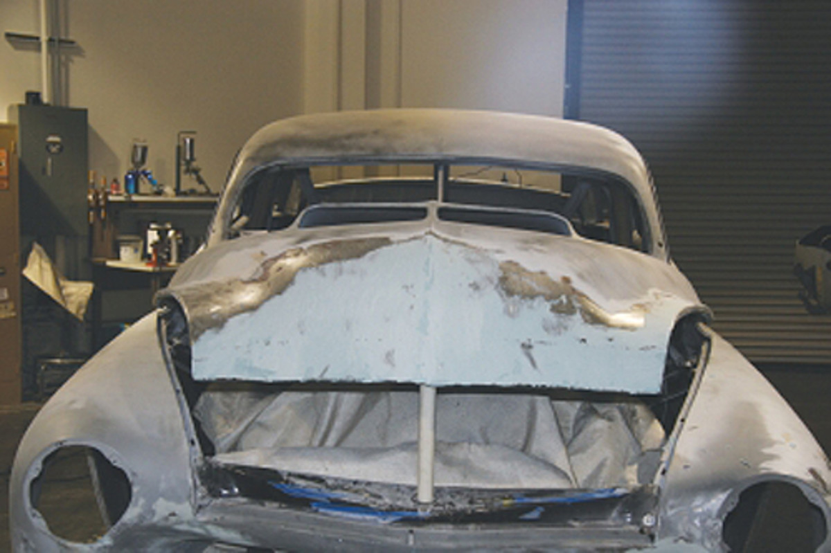 On this famous car we needed to save the severely rusted-out hood, as it was the custom one we built for the film Cobra. The metal was replaced and hammered into shape and then worked to a finish with a thin coat of filler.