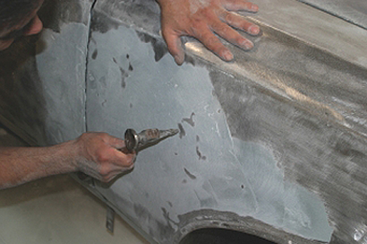 High spots can be picked down carefully with light hammering. Another thin coating of filler will be required.