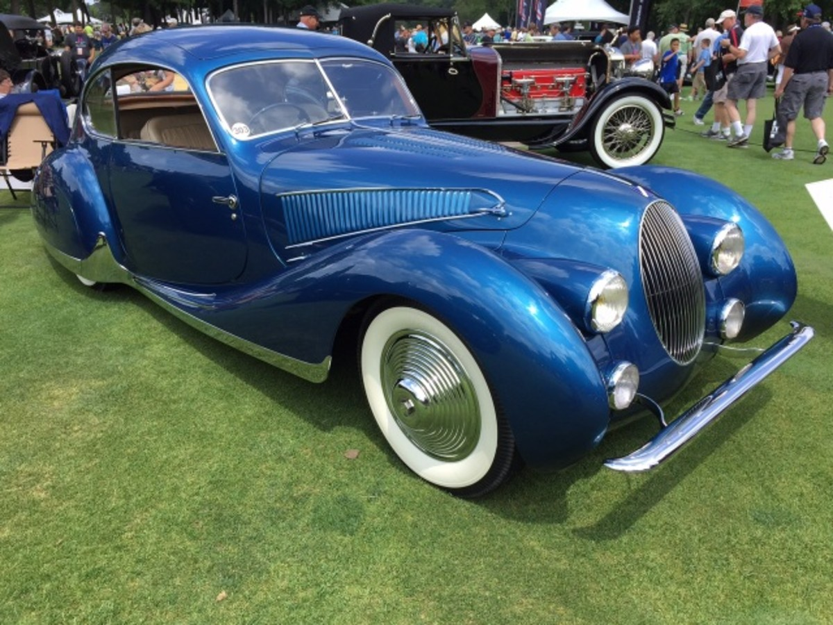 A 1938 Talbot-Lago T23 with coachwork by Figoni et Falaschi. Thsi car was built by the same coachbuilding firm that creating this year's Best of Show winner at the Concours d'Elegance of America, but notice the headlamps are not fared into the fenders and the roof is not as teardrop-shaped as the Best of Show winner.