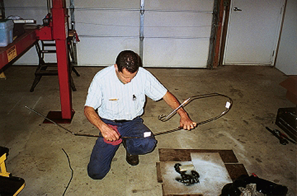 Vince Sauberlich is shown removing two shipping bends from the longest brake line. Shade-tree restorers may want to use a sandbag or bending tool. Whatever technique you use, go slow and don't force anything.