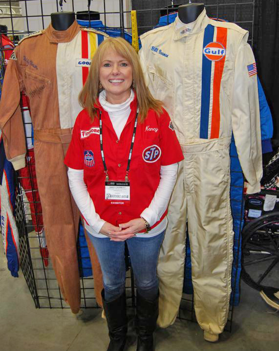 Hinchman owner Nancy Chumbley stands by a tan suit Bobby Unser once wore.